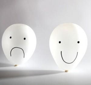 Happy and sad balloon faces
